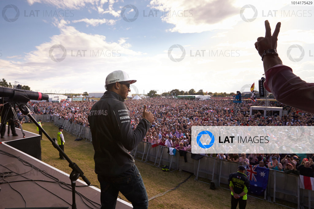 Silverstone, Northamptonshire, England. Sunday 6 July 2014. Lewis Hamilton, Mercedes AMG, gives the crowd a thumbs up. World Copyright: Steve Etherington/LAT Photographic. ref: Digital Image SNE10011