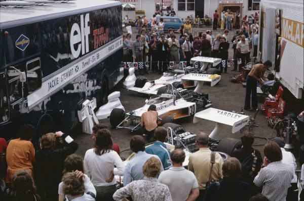 1973 British Grand Prix.  Silverstone, England. 12-14th July 1973.  Fans in the paddock watch as mechanics work on the three McLaren M23 Fords.  Ref: 73GB69. World Copyright: LAT Photographic