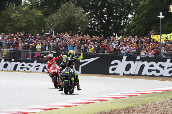 British Grand Prix.  Silverstone, England. 30th August - 1st September 2013.  Cal Crutchlow, Tech 3 Yamaha, Valentino Rossi, Yamaha, and Nicky Hayden, Ducati, wave to the crowd.  Ref: IMG_2423a. World copyright: Kevin Wood/LAT Photographic