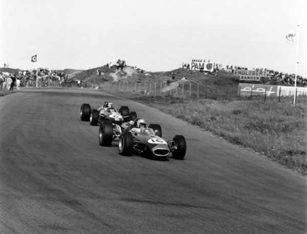1966 Dutch Grand Prix.Zandvoort, Holland. 24 July 1966.Jack Brabham, Brabham BT19-Repco, 1st position, leads Jim Clark, Lotus 33-Climax, 3rd position, action.World Copyright: LAT PhotographicRef: 35917
