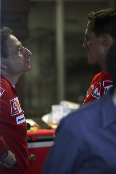 2006 Japanese Grand Prix - Sunday Race Suzuka, Japan. 5th - 8th October 2006 Michael Schumacher, Ferrari 248F1, retired, talks to Jean Todt in the pits, portrait. World Copyright: Charles Coates/LAT Photographic. ref: Digital Image MB5C5348