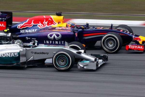 Shanghai International Circuit, Shanghai, China. Sunday 20 April 2014. Nico Rosberg, Mercedes W05, passes Sebastian Vettel, Red Bull Racing RB10 Renault. World Copyright: Glenn Dunbar/LAT Photographic. ref: Digital Image _89P2776