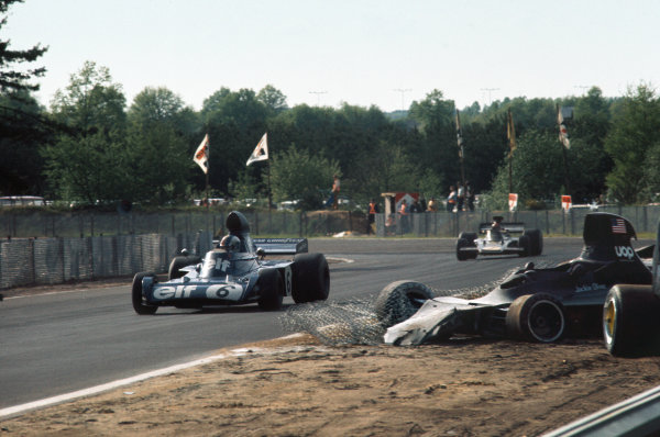 1973 Belgian Grand Prix.  Zolder, Belgium. 18-20th May 1973.  François Cevert, Tyrrell 006 Ford, 2nd position, leads Emerson Fittipaldi, Lotus 72E Ford, 3rd position, past the crashed Shadow DN1 Ford of Jackie Oliver.  Ref: 73BEL28. World Copyright: LAT Photographic