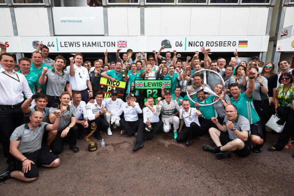 Monte Carlo, Monaco. Sunday 25 May 2014. Nico Rosberg, Mercedes AMG, 1st Position, Lewis Hamilton, Mercedes AMG, 2nd Position, Toto Wolff, Executive Director (Business), Mercedes AMG, Dr Dieter Zetsche, CEO, Mercedes Benz, Paddy Lowe, Executive Director (Technical), Mercedes AMG, and the Mercedes AMG team celebrate. World Copyright: Steve Etherington/LAT Photographic. ref: Digital Image SNE20196 copy