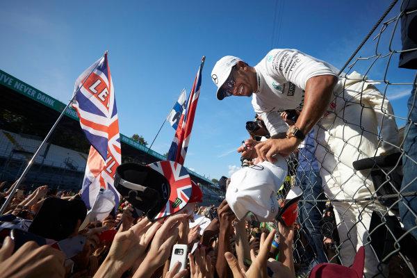 Autodromo Nazionale di Monza, Italy. Sunday 3 September 2017. Lewis Hamilton, Mercedes AMG, signs autographs for fans. World Copyright: Steve Etherington/LAT Images  ref: Digital Image SNE15540