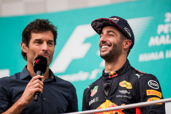 Sepang International Circuit, Sepang, Malaysia. Sunday 1 October 2017. Mark Webber, TV Pundit, Channel 4 F1, interviews Daniel Ricciardo, Red Bull Racing, 3rd Position, on the podium. World Copyright: Zak Mauger/LAT Images  ref: Digital Image _56I3568