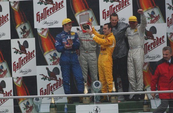DTM Championship 2002, Round 10 - Hockenheimring, Germany, 6 October 2002 - During the last podium ceremony of the 2002 season, Laurent Aiello (Team Abt Sportsline) is presented with a plague for the 2002 DTM Drivers Championship.