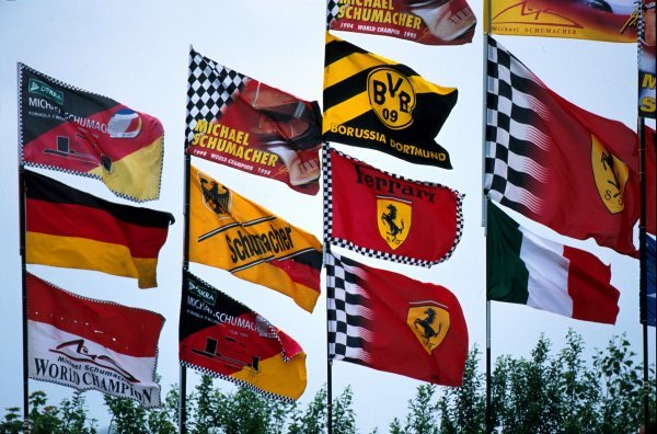 The flags showed that the crowds allegiance was with local hero Michael Schumacher (GER) and Ferrari.European Grand Prix, Rd9, Nurburgring, Germany. 23 June 2002.BEST IMAGE