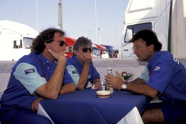 Eddie Jordan (IRE), Jordan Grand Prix Team Owner, right, chats to Ian Phillips (GBR), Jordan Grand Prix Commercial Director and John Walton (GBR). German Grand Prix, Rd10, Hockenheim, Germany, 26 July 1992.