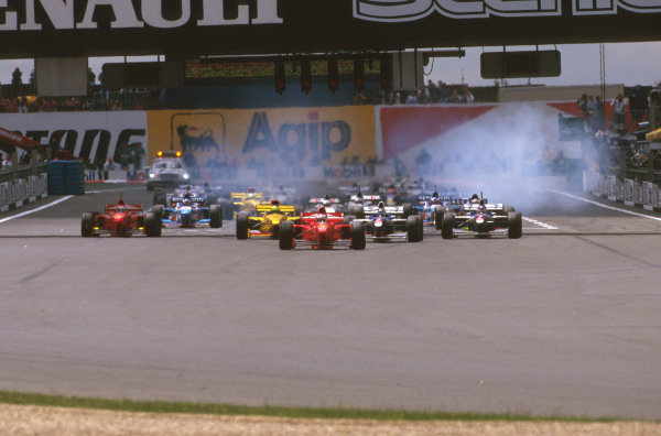 Magny-Cours, France.27-29 June 1997.Michael Schumacher (Ferrari F310B) leads the rest of the field away at the start.Ref-97 FRA 12.World  Copyright - LAT Photographic