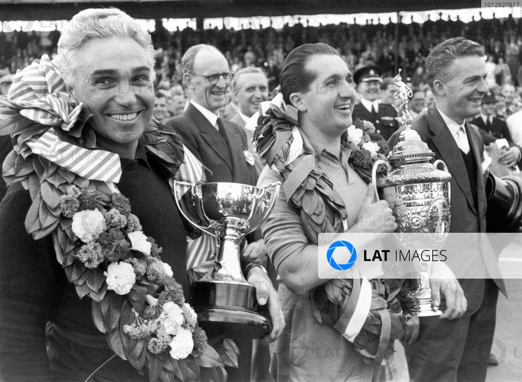 1952 World Championship.British Grand Prix.Piero Taruffi (left) and winner Alberto Ascari (centre).World Copyright: LAT Photographic.ref: 52/38 38A, 50mb Scan.