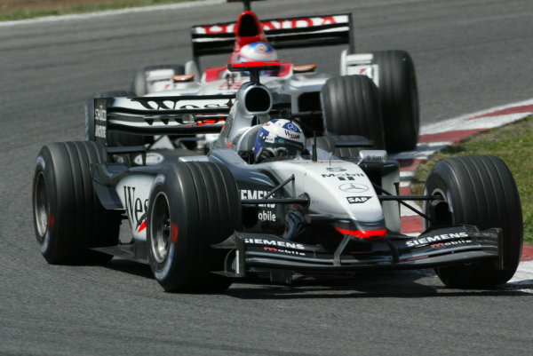2003 Spanish Grand Prix - Sunday Race,Barcelona, Spain.4th May 2003.David Coulthard, West McLaren Mercedes MP4/17D, leads Jenson Button, B-A-R Honda 005, action.World Copyright LAT Photographic.ref: Digital Image Only.