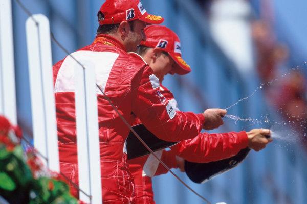 2004 French Grand PrixMagny-Cours, France. 2nd - 4th JulyMichael Schumacher, Ferrari F2004 and team mate Rubens Barrichello, Ferrari F2004 celebrate on the podium. World Copyright: LAT PhotographicRef:35mm Image A03