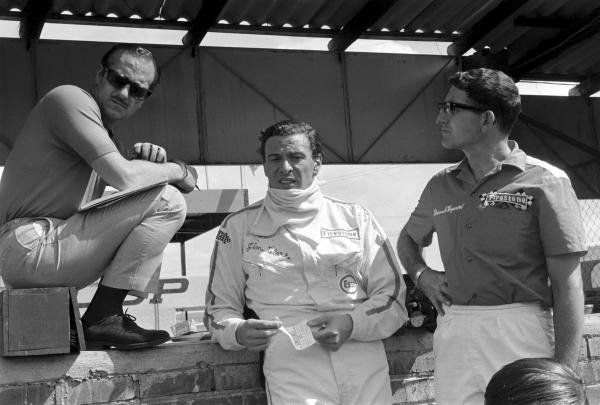 (L to R): Lotus team owner Colin Chapman; race winner Jim Clark (GBR); Brian Hayward, Firestone tyre engineer.  