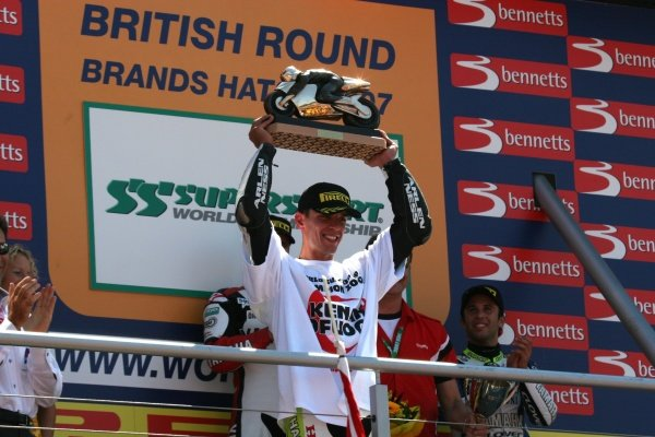 2007 World Supersport Championship. Brands Hatch, England. 3rd - 5th August 2007. Kenan Sofuoglu celebrates becoming World Champion on the podium. World Copyright: Kevin Wood/LAT Photographic ref: Digital Image