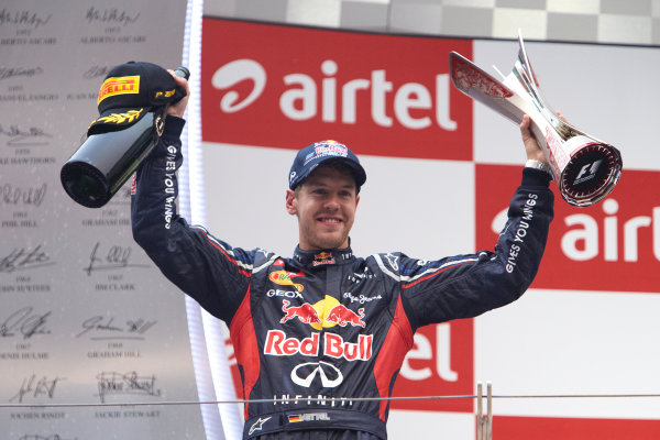 2012 Indian Grand Prix - Sunday Buddh International Circuit, New Delhi, India. 28th October 2012. Sebastian Vettel, Red Bull Racing, 1st position, with his trophy and Champagne. World Copyright:Steve Etherington/LAT Photographic ref: Digital Image SNE19911 copy