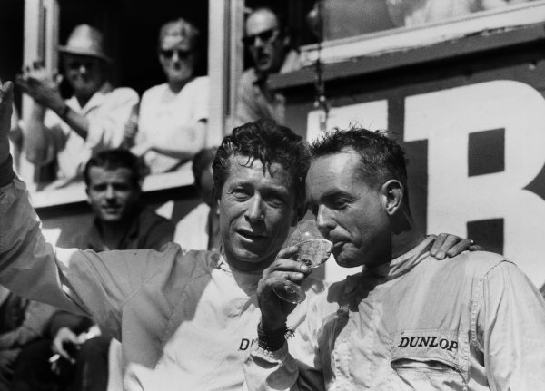 Le Mans, France. 10th - 11th June 1961 Olivier Gendebien and Phil Hill, 1st position, celebrate on the podium with a glass of champagne, portrait. World Copyright: LAT Photographic Ref:  L1206 - 31.