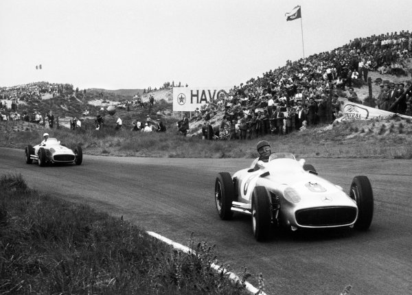 Zandvoort, Holland. 19th June 1955.Juan Manuel Fangio (Mercedes-Benz W196),1st position, leads Stirling Moss (Mercedes-Benz W196), 2nd position, action.World Copyright: LAT Photographic.