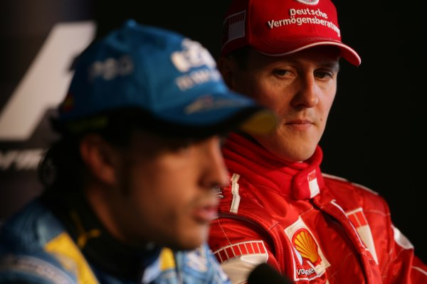 2006 British Grand Prix - Saturday Qualifying Silverstone, England. 8th - 11th June. Fernando Alonso, Renault R26 and Michael Schumacher, Ferrari 248F1 take questions in the FIA pole winners press conference, portrait. World Copyright: Charles Coates/LAT Photographic ref: Digital Image ZK5Y2307