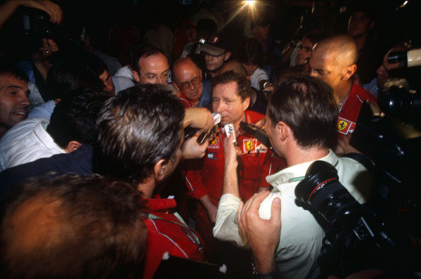 Sepang, Kuala Lumpur, Malaysia. 15-17 October 1999. Jean Todt faces a media scrum after both Ferraris were excluded from the event. Ref: 99MAL67. World Copyright - LAT Photographic