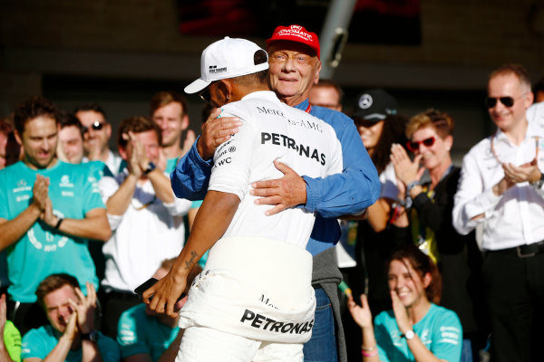 Circuit of the Americas, Austin, Texas, United States of America. Sunday 22 October 2017. Lewis Hamilton, Mercedes AMG, and Niki Lauda, Non-Executive Chairman, Mercedes AMG, celebrate Constructors' Championship victory with the rest of the team. World Copyright: Andy Hone/LAT Images  ref: Digital Image _ONY2526