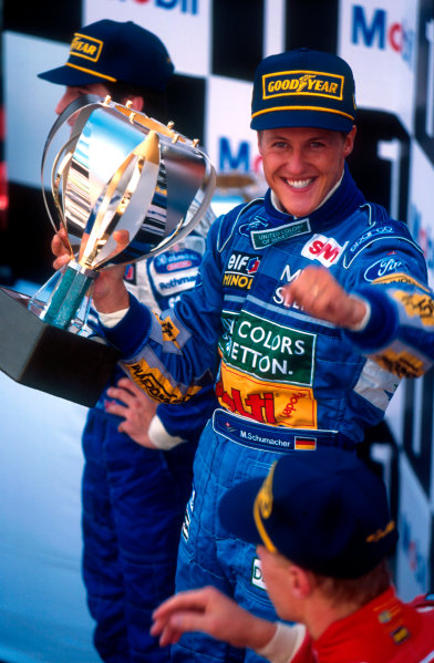 1994 Belgian Grand Prix.Spa-Francorchamps, Belgian.26-28 August 1994.Michael Schumacher (Benetton Ford) 1st position, but later disqualified because his skidblock or plank from the car's undertray was found to be below the required legal measurement. Behind Damon Hill (Williams Renault) now 1st position and infront Mika Hakkinen (McLaren Peugeot) now 2nd position on the podium. Ref-94 BEL 03.World Copyright - LAT Photographic