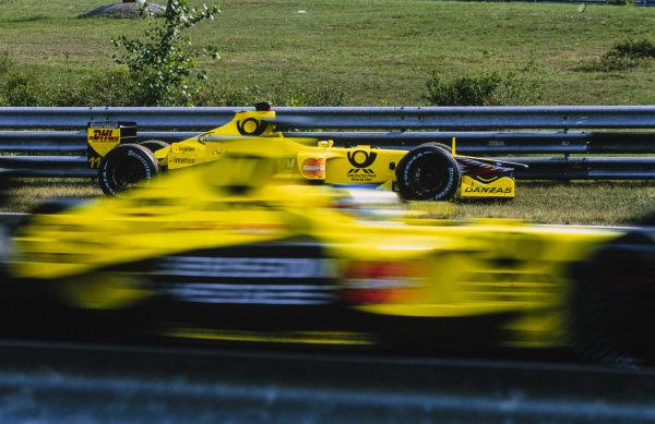 Jean Alesi, Jordan EJ11 Honda, drives past the stranded car of Jarno Trulli, Jordan EJ11 Honda.