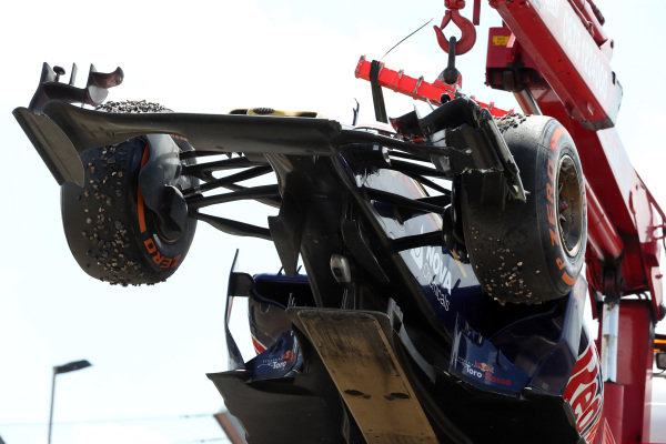 Max Verstappen (NED) Scuderia Toro Rosso STR10 is recovered after crashing into the gravel at Formula One World Championship, Rd9, British Grand Prix, Race, Silverstone, England, Sunday 5 July 2015.