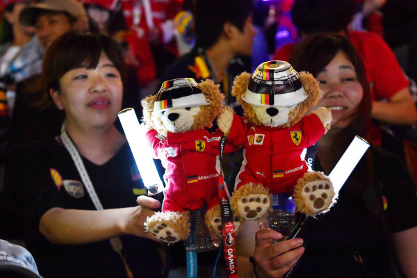 SUZUKA, JAPAN - OCTOBER 06: Fans with teddy bears during the Japanese GP at Suzuka on October 06, 2018 in Suzuka, Japan. (Photo by Jerry Andre / Sutton Images)