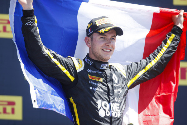 Anthoine Hubert (FRA, BWT ARDEN), celebrates victory on the podium by holding a French Tricolore