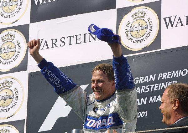 2001 San Marino Grand Prix.Imola, Italy. 13-15 April 2001.Ralf Schumacher (Williams BMW) celebrates his maiden Grand Prix win on the podium.World Copyright - Steve Etherington/LAT Photographicref: 9 mb digital image.