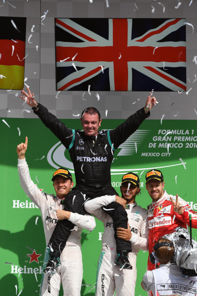 (L to R): Nico Rosberg (GER) Mercedes AMG F1,Tom Walton (GBR) Mercedes AMG F1 Engineer, Lewis Hamilton (GBR) Mercedes AMG F1 and Sebastian Vettel (GER) Ferrari celebrate on the podium at Formula One World Championship, Rd19, Mexican Grand Prix, Race, Circuit Hermanos Rodriguez, Mexico City, Mexico, Sunday 30 October 2016.