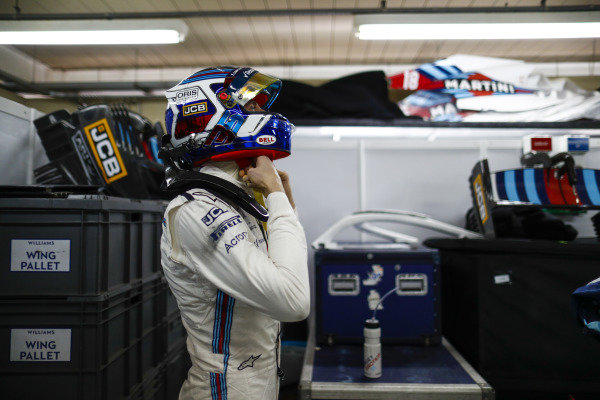 Sergey Sirotkin, Williams Racing, adjusts his crash helmet.