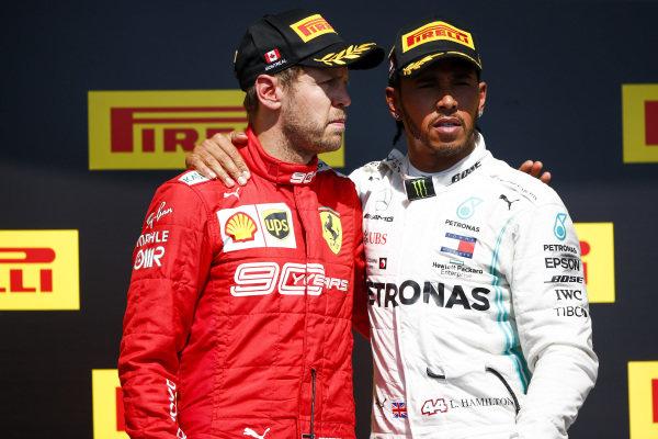 Sebastian Vettel, Ferrari and Lewis Hamilton, Mercedes AMG F1 on the top step of the podium