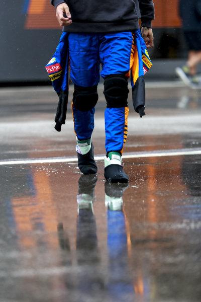 Daniel Ricciardo, McLaren MCL35M walking in the rain