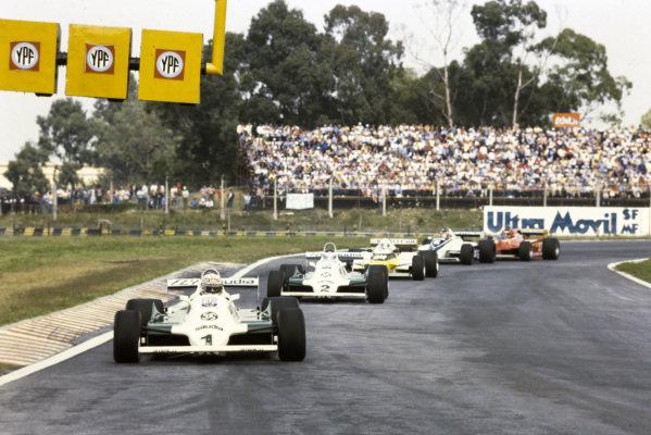 Alan Jones, Williams FW07C Ford, leads Carlos Reutemann, Williams FW07C Ford, René Arnoux, Renault RE20B, Hector Rebaque, Brabham BT49C Ford, and Gilles Villeneuve, Ferrari 126CK.