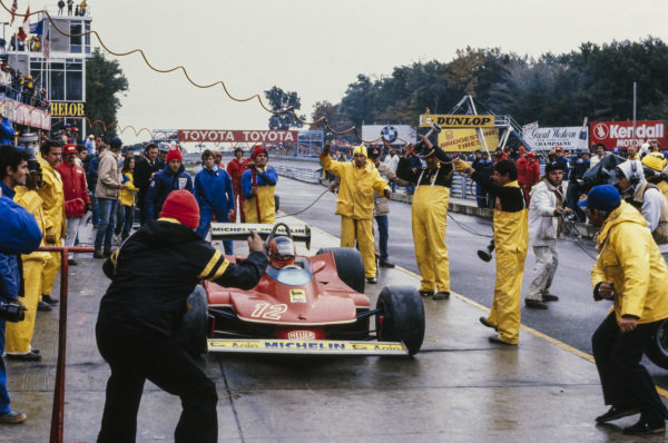 Gilles Villeneuve, Ferrari 312T4 being signalled out after his pit stop.