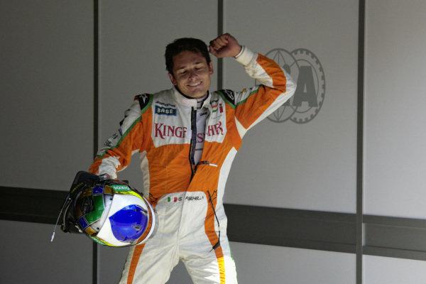 Giancarlo Fisichella celebrates his unexpected pole position in parc ferme.