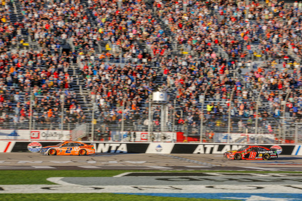 #2: Brad Keselowski, Team Penske, Ford Mustang beats #19: Martin Truex Jr., Joe Gibbs Racing, Toyota Camry Bass Pro Shops to the checkered flag