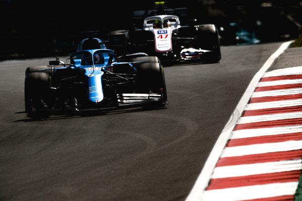 Fernando Alonso, Alpine A521, leads Mick Schumacher, Haas VF-21