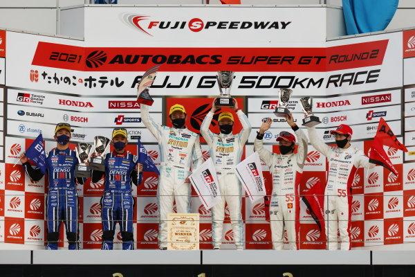 GT300 Winners Hiroki Yoshimoto & Shunsuke Kohno, SYNTIUM LMcorsa Toyota GR Supra GT, celebrate on the podium. Alongside are Takuto Iguchi & Hideki Yamauchi, SUBARU BRZ R&D SPORT, 2nd in GT300, and Shinichi Takagi & Ren Sato, ARTA Honda NSX GT3, 3rd in GT300