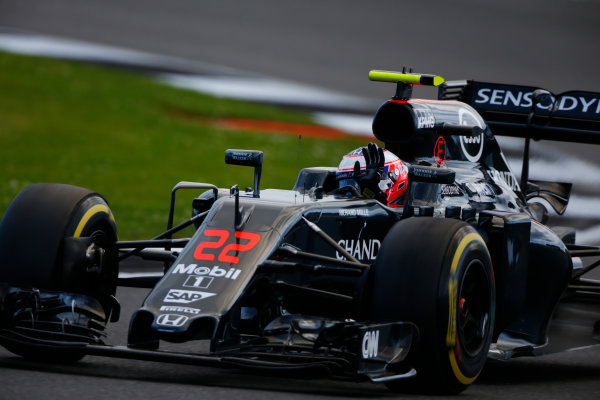 Silverstone, Northamptonshire, UK Friday 08 July 2016. Jenson Button, McLaren MP4-31 Honda, waves to spectators. World Copyright: Andy Hone/LAT Photographic ref: Digital Image _ONY8053