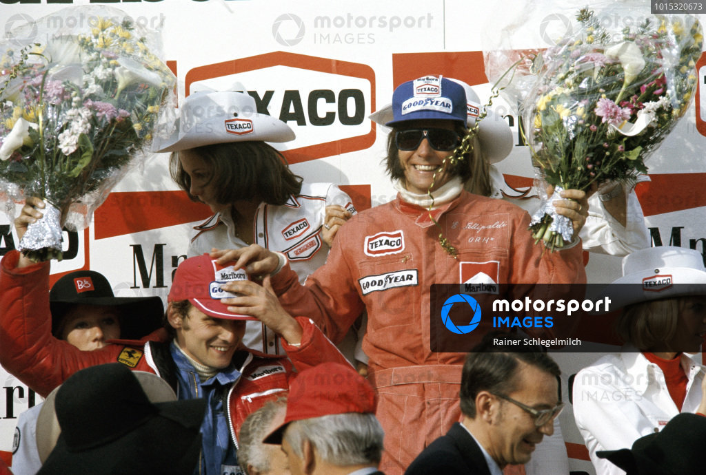 Emerson Fittipaldi celebrates victory with second place Niki Lauda.