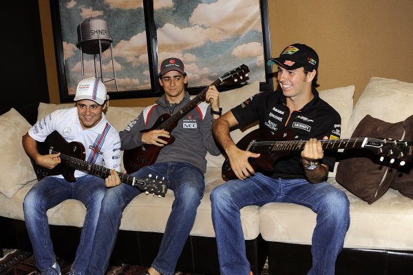 (L to R): Felipe Massa (BRA) Williams Martini Racing; Esteban Gutierrez (MEX) Sauber and Sergio Perez (MEX) Force India with their personalised Gibson Les Paul guitars. The event took place at the Austin Fans Forum in association with the Grand Prix Investors Fund that was held in the iconic Gibson Guitars showroom. Formula One World Championship, Rd17, United States Grand Prix, Preparations, Austin, Texas, USA, Wednesday 29 October 2014.
