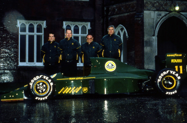 (L to R): Clive Chapman (GBR); Peter Collins (AUS) Lotus Team Manager; Horst Schubel (GER) Investor; and Peter Wright (GBR) Team Lotus Technical Director, with the Lotus 102B.