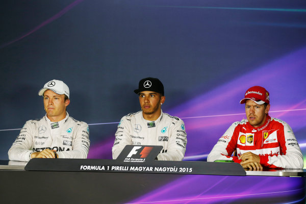 Hungaroring, Budapest, Hungary. Saturday 25 July 2015. Top three qualifiers Lewis Hamilton, Mercedes AMG, Nico Rosberg, Mercedes AMG, and Sebastian Vettel, Ferrari, in the Press Conference. World Copyright: Alastair Staley/LAT Photographic ref: Digital Image _R6T9767