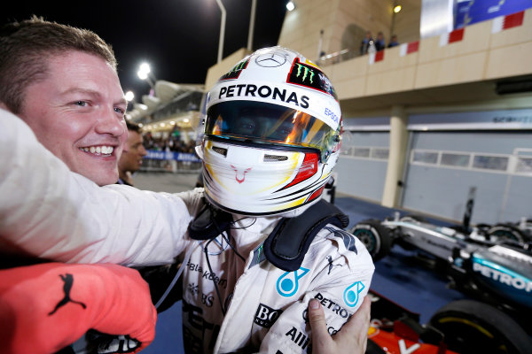Bahrain International Circuit, Sakhir, Bahrain. Sunday 19 April 2015. Lewis Hamilton, Mercedes AMG, 1st Position, celebrates in Parc Ferme with his team. World Copyright: Charles Coates/LAT Photographic. ref: Digital Image _J5R1156
