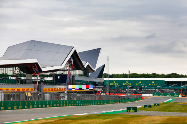 Silverstone, Northamptonshire, UK.  Thursday 13 July 2017. Clouds gather over the grid and the Wing pit building. World Copyright: Andy Hone/LAT Images  ref: Digital Image _ONY4659