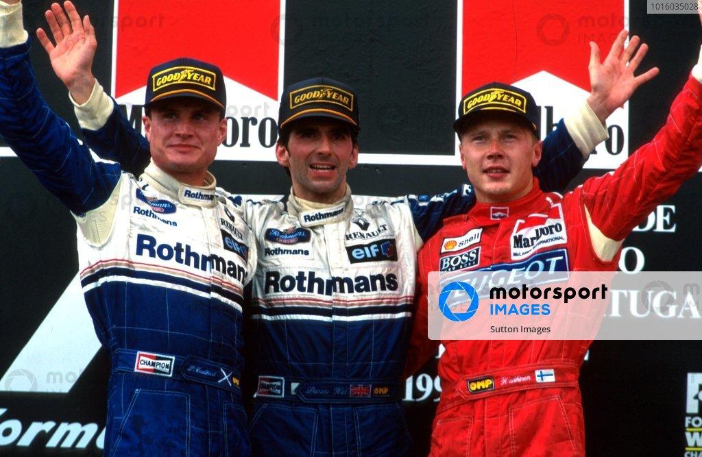 L to R: David Coulthard 2nd, Winner Damon Hill and Mika Hakkinen 3rd Portugese GP, Estoril, 25  September 1994