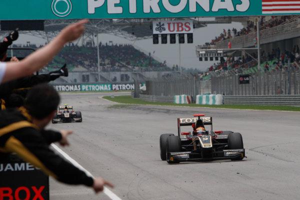 Sepang, Kuala Lumpur, Malaysia. 25th March 2012. Sunday Race.James Calado (GBR, Lotus GP) crosses the line to take victory. Action.World Copyright: Alastair Staley/GP2 Series Media Service.Ref: Digital Image _O9T2625.jpg